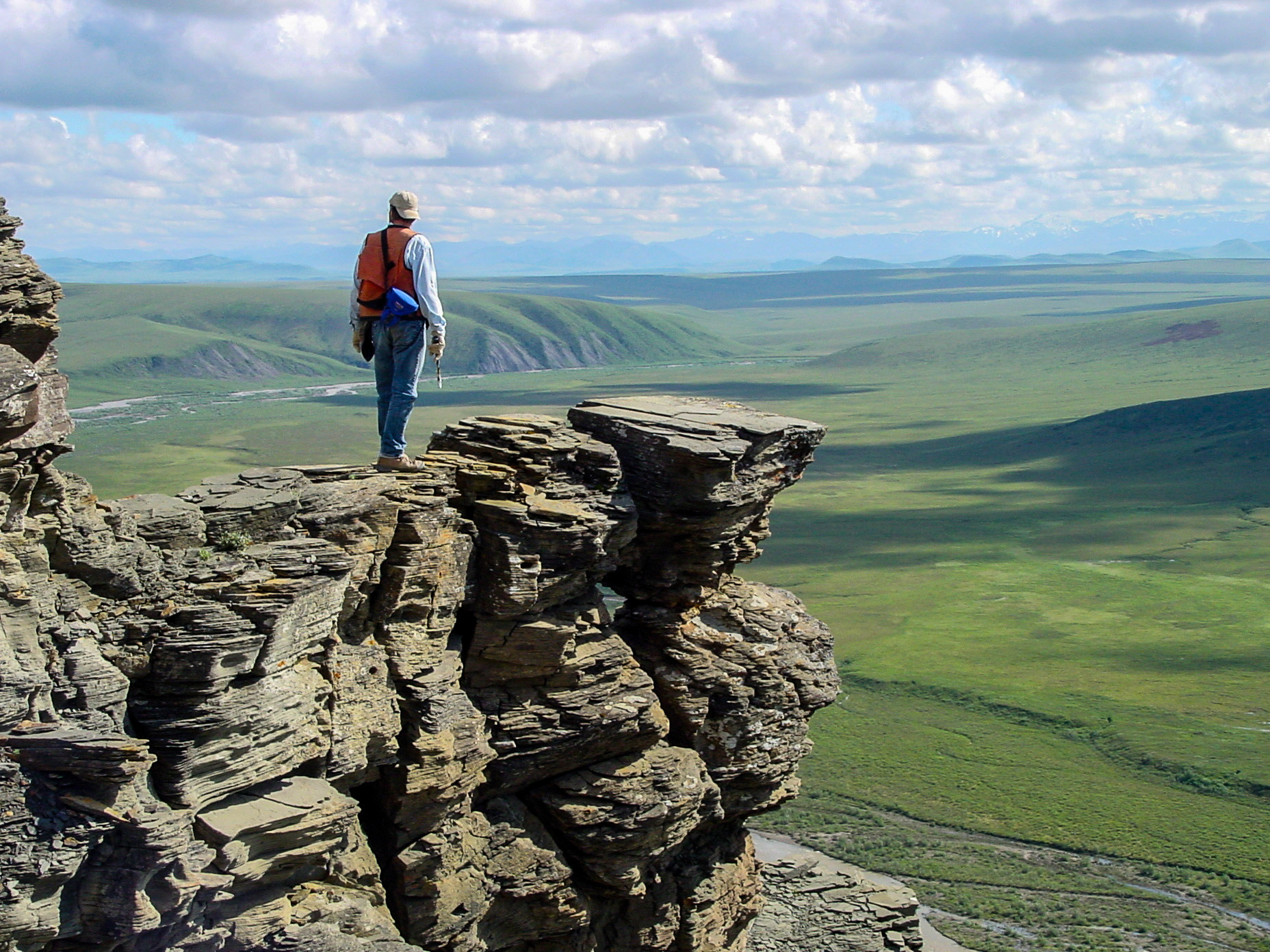 Not that we want to make you jealous about the amazing places we work...OK, OK, we're definitely trying to make you jealous...here's a shot of a geologist on an outcrop of Nanushuk Formation, Tuktu Bluff, Alaska in the summer of 2004. Photographer: Dave Houseknecht, USGS.